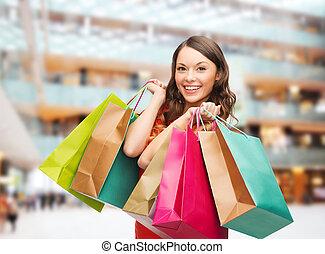 sorrindo, mulher, coloridos, shopping, sacolas
