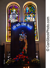 Peter Shrine Statue Stained Glass Notre Dame Cathedral, Nha Tho Duc Ba, built in 1883 largest cathedral in French Empire Virgin Mary Statue Added in 1959 Saigon Ho Chi Minh City Vietnam