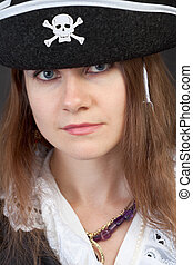 Portrait of serious pirate woman in hat close-up