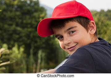 children - portrait of boy in the foreground with red cap
