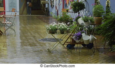 downpour in small shopping area - downpour in small historic...