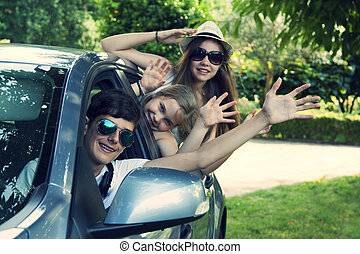 travel by car - happy people traveling by car, vintage...