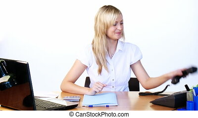 Businesswoman using a laptop in office footage