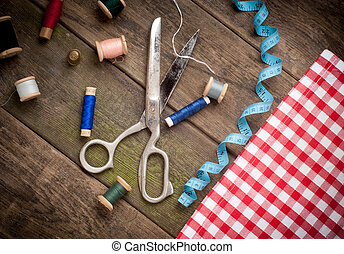 Vintage Background with sewing tools and colored tape Sewing...