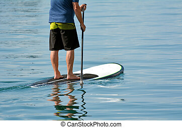 Man on stand up paddling