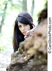 lonley and scared beautiful woman in the woods - portrait of...