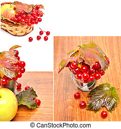 Red viburnum berries in the glass and an apple on the wooden...