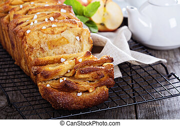 Apple cinnamon pull-apart bread on cooling rack