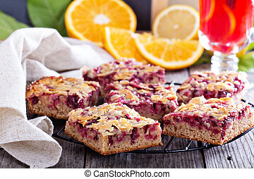 Berry cake bars with caramel almond topping on a cooling...