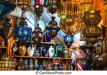 Traditional glass and metal lamps in shop in the medina of...