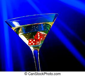 red dice in the cocktail glass on blue light casino concept...