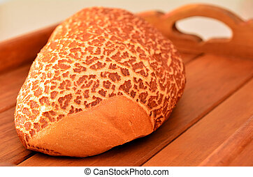 Tiger Bread on wooden tray,