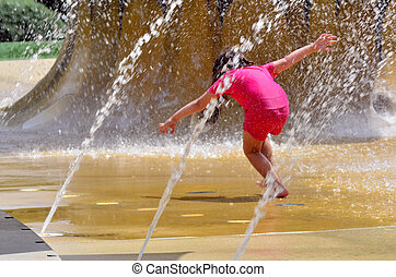 Child play with water fountain. - Child (girl age 04) play...