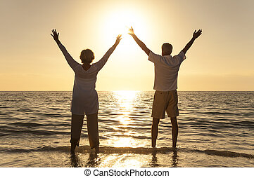Senior Man and Woman Couple Sunset on Beach - Senior man and...