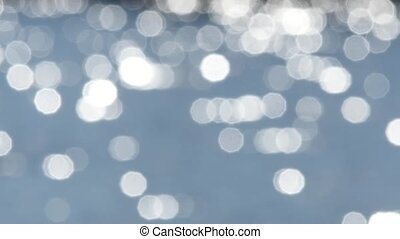 Abstract blue bokeh shiny water background