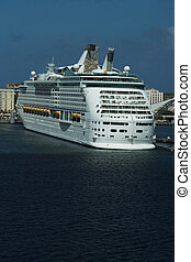 luxury white cruise ship shot at high angle level on a clear day with calm seas and blue sky