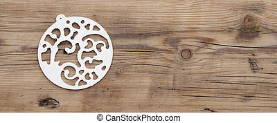 A singel christmas ball on wood with copy space