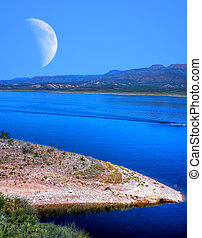 Roosevelt Lake and Moon - Roosevelt Lake with large moon in...