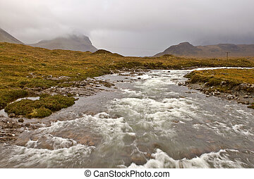 River of Sligachan with Cuillins Hills to the fund. Isle of...