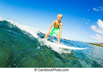 Boy Surfing Ocean Wave - Young Boy Surfing Ocean Wave