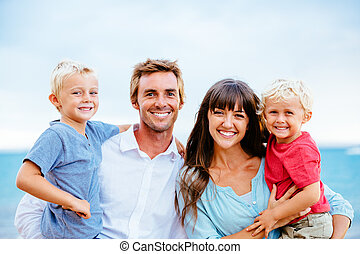 Happy Family with Young Kids