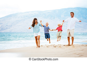 Happy Family at Sunset - Happy Young Family Walking Down the...