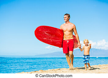 Father and Son Going Surfing at the Beach