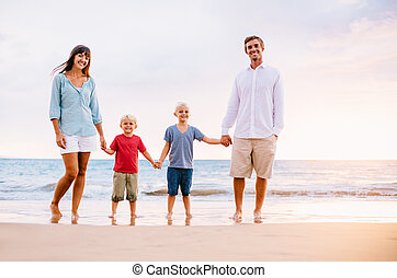 Portrait of Family on the Beach at Sunset - Happy Family of...