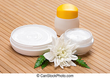 Natural moisturizing face and body cream concept: jars of...