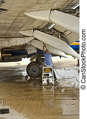 flap wash _02.jpg - Airline employee washes underside of...