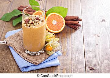 Pumpkin smoothie with granola on top - Pumpkin smoothie...