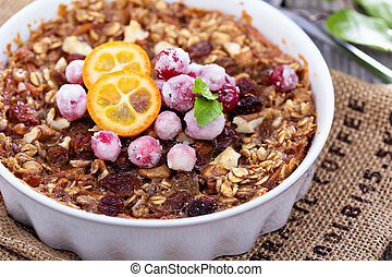 Baked oatmeal with carrot, walnuts and raisins, served with...