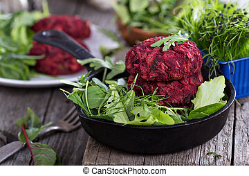 Vegan burgers with beetroot and beans served with fresh...