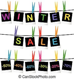 Winter sale concept with photo frames hanging on clothespins