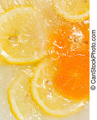 bright lemon and orange - sweet cold ice frozen ripe bright...