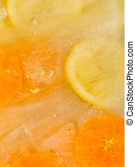 oranges and lemons - cold sweet ice with frozen oranges and...