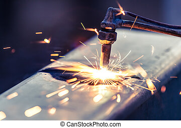 worker cutting steel pipe using metal torch and install...