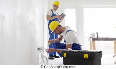 builders with tablet pc and equipment indoors - building,...