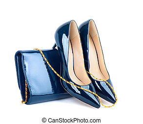 Beautiful blue shoes with clutches on white isolated...