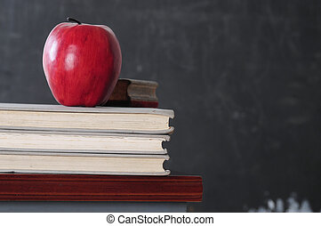 Back to school - Books and apple in a classroom