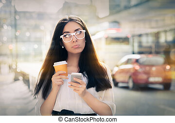 Woman Holding Smartphone and Coffee - Expressive woman...