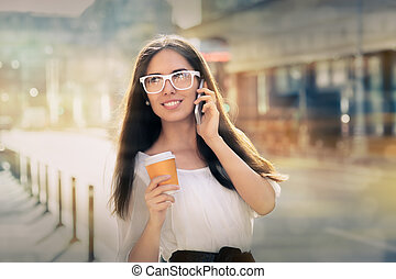 Woman with Coffee Cup on the Phone