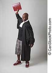 Throwing the book - Mid-forty year old bald black man,...