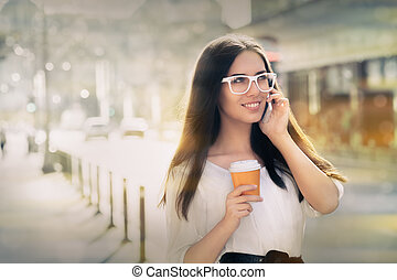 Woman with Coffee Cup on the Phone - Woman smiling and...