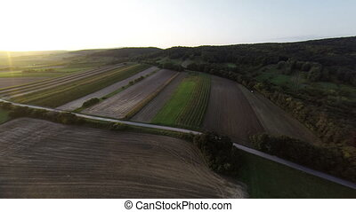Sunset over hills aerial footage