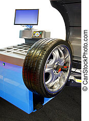 Tyre balancing - Close up shot of tyre balancing machine