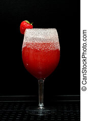 non-alcoholic fruit with strawberry - glass cup with...