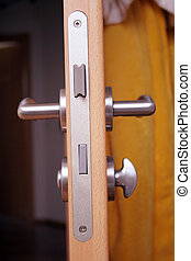 doorhandle - wooden door with silver doorhandle at home