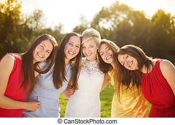 Bride with her friends - Outdoor portrait of beautiful young...