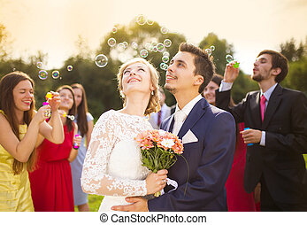 Newlyweds at wedding reception - Young newlyweds enjoying...